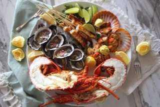 منها المأكولات البحرية والدجاج.. أطعمة تساعد على تكبير حجم الثدي